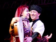 Dancing couple. Singer Leman Sam performs live during a concert dedicated to the International Women's Day at Maltepe open air stage on May 8, 2011 in Istanbul Stock Photo