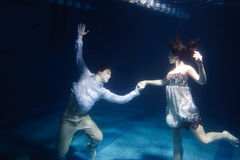 Dancing couple. Under water in swimming pool Stock Photo
