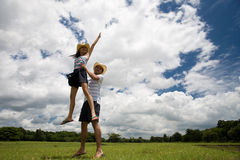 Dancing Couple. A couple dancing in the outdoors on grass, beneath a cloudy sky Royalty Free Stock Photography