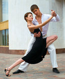 Dancing couple. Young couple dancing Latino dance against urban landscape Stock Image