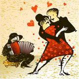 Dancing couple and accordion player Stock Images