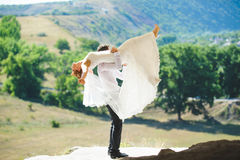 Dancing Couple. Bride and groom dancing on hill Royalty Free Stock Images