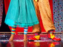 Dancing couple of clowns on stage royalty free stock photo