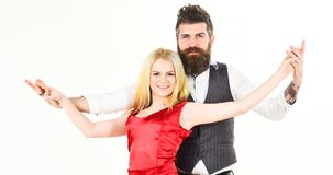 Dancing couple concept. Couple in love, cheerful dancers in elegant clothes, white background. Woman in red dress and. Men in vest. Bearded hipster and Stock Images
