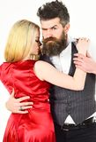 Dancing couple concept. Woman in red dress and man in vest cuddling while dancing. Bearded hipster and attractive lady. Dancing couple concept. Woman in red Stock Photography