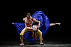 The dancing couple in the darkness, making dance support in movement. royalty free stock images
