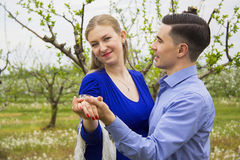 Dancing couple in garden Royalty Free Stock Images