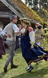 Dancing couple in the Latvian national costume Stock Photography