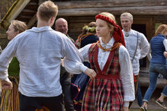 Dancing couple in the Latvian national costume Stock Photos