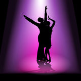 Dancing couple in spotlight Stock Photo