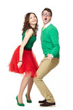 Dancing couple wearing bright clothes. Interracial weird nerd couple dancing together. Excited caucasian young men wearing eyeglasses and smiling asian women stock photos