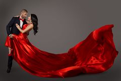 Dancing Couple, Woman in Red Dress and Man in Suit, Waving Fabric stock photos