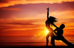 Dancing Couples on the Beach Stock Image