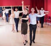 Dancing couples enjoying latin dances Royalty Free Stock Photography
