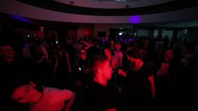 Dancing crowd in night club overhead shot. Drive and emotions stock footage