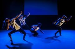 Dancing in dark studio Stock Images