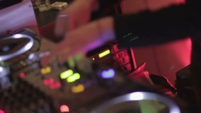 Dancing deejay performing modern music in the popular night club. Nightlife. Stock footage stock footage