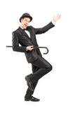 Dancing dell'esecutore con una canna Fotografie Stock