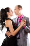Dancing della moglie e del marito su una priorità bassa bianca Fotografia Stock