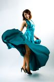 dancing della ragazza nel vestito Fotografia Stock