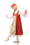 Dancing della ragazza in vestito nazionale Fotografia Stock Libera da Diritti