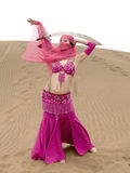 Dancing at desert with sabre Royalty Free Stock Photo