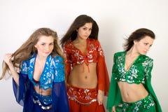 Dancing di pancia delle tre ragazze Fotografia Stock