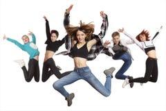 Dancing di pratica del gruppo della donna isolato su bianco fotografia stock