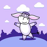 Dancing donkey on the lawn. A cheerful dancing donkey cat on a glade of purple hue Royalty Free Stock Photo