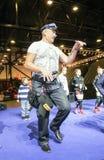 Dancing elderly presenter. royalty free stock image