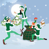 Dancing elf with Christmas gifts Stock Image
