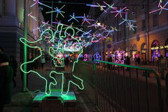 Dancing everywhere. Photo street in the center of Moscow, decorated with light figures dancing couples - Christmas decorations stock photo