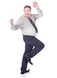 Dancing excited businessman. Full body dancing and cheering businessman with hands up in joy. Isolated over white except natural shadows under feet Royalty Free Stock Photos
