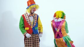 Dancing excited clowns turning round themselves stock video footage