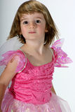 Dancing fairy girl. Cute toddler girl in a pink dress with fairy wings dancing stock photography
