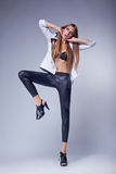 Dancing fashion provocative bright girl  Stock Photos