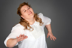 Dancing fat woman Royalty Free Stock Photography