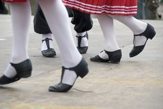 Dancing feet. Three girls dancing a folk dance, only the legs and feet to be seen Stock Photography