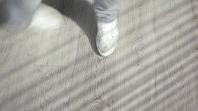 Dancing feet in white sneakers. Feet of hip hop dancer on dance floor. Dynamic of modern dance movement stock video