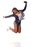 Dancing felice di salto che ascolta la musica Fotografia Stock