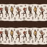 Dancing figures wearing African masks. Royalty Free Stock Photo