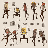 Dancing figures wearing African masks. Stock Images