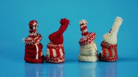 Dancing figures in winter clothes. stock video footage