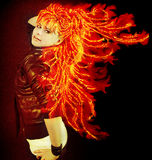 Dancing fire. Dancing young woman with long  fiery hair Stock Photography