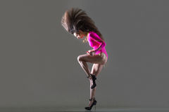 Dancing fit girl with flying hair Royalty Free Stock Photo