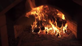 Dancing flame in a stove stock footage