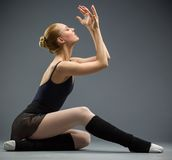 Dancing on the floor ballerina with hands up royalty free stock photography