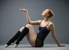 Dancing on the floor ballerina with palm up Stock Photography