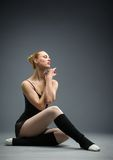 Dancing on the floor ballet dancer with her eyes closed Royalty Free Stock Photos