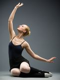 Dancing on the floor ballet dancer with her hand up Royalty Free Stock Photography
